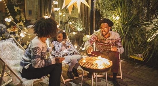 Family roasting marshmallows over a barbequeFamily roosting marshmellows over a barbque