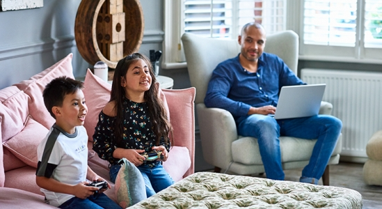 Father with 2 kids sitting in a living room