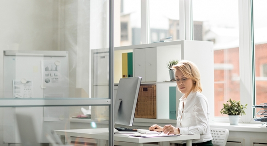 Lady in an office at her computer