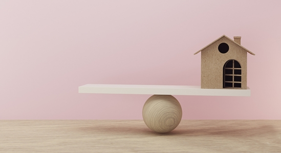Tetter totter with a house on one side