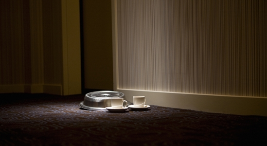 picture of food tray outside a hotel room door