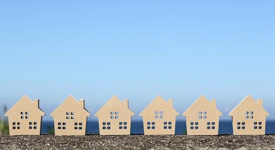 row of cardboard house cutouts
